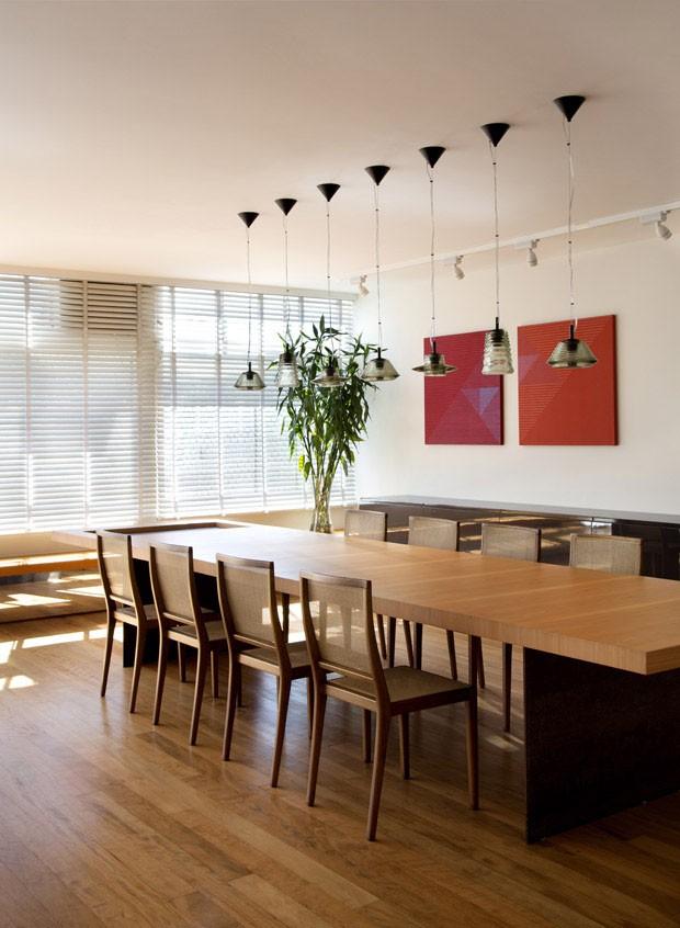 Sala de jantar e de estar integradas com harmonia